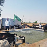 A touching gesture: Abdul Ghafarsab Mulla has installed a pumpset to store water in a large trough for local residents and their livestock to quench their thirst, in Yadgir district. photo: Ravikumar Naraboli
