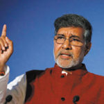 Nobel peace laureate and children's rights activist Kailash Satyarthi gestures while speaking at the Trust Women conference in London November 19, 2014. Satyarthi called on Monday for global support for a campaign to end child slavery that will be launched this week as new figures estimated almost 36 million people are living as slaves today. REUTERS/Suzanne Plunkett (BRITAIN - Tags: SOCIETY) - RTR4EPF6