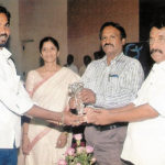 Abbas (left) getting  an award for providing blood to Coimbatore government hospital